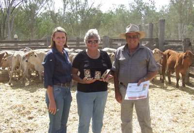 Eidsvold Saleyard's identity, Tanya Harm with acclaimed Charbray producers, Harold and Pam Dwyer.