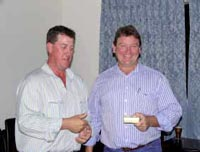 Outgoing President, Paul Weir congratulates 2009/10 President, Matthew Welsh, Huntington Charbrays.