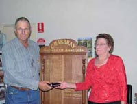 Councillor, Grant Sherriff presents Jill Olman with Life Member Badge.